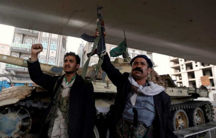 Houthi fighters react after Yemen's ex-president Ali Abdullah Saleh was killed.