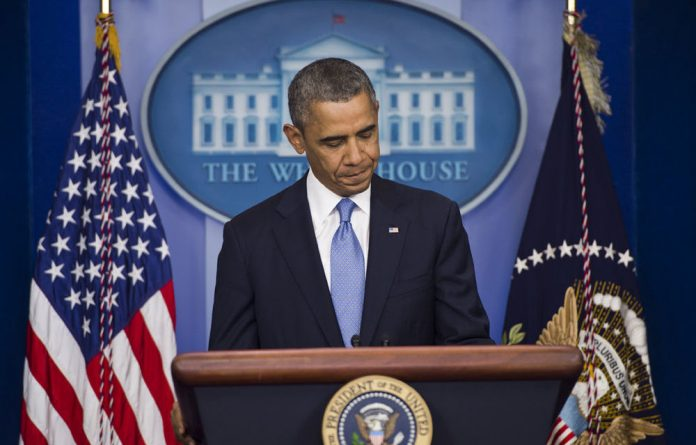 US President Barack Obama speaks at a press briefing at the White House.