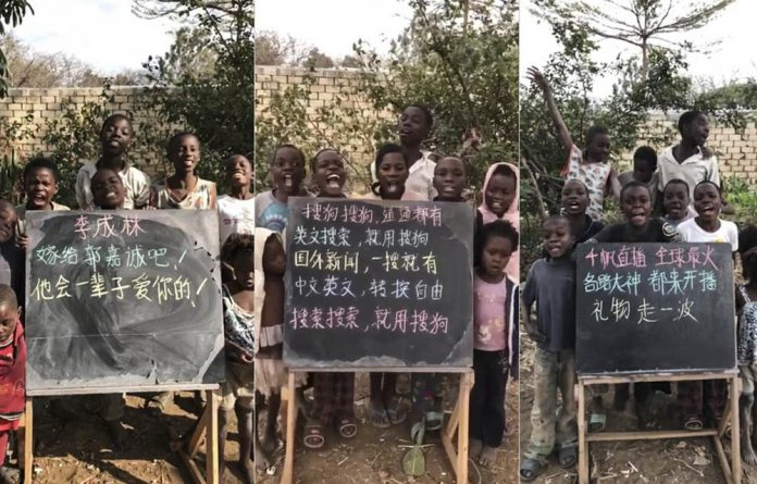 Africa in China: Chinese vendors have come under fire for selling videos and photos of African children carrying personalised messages and advertising businesses.