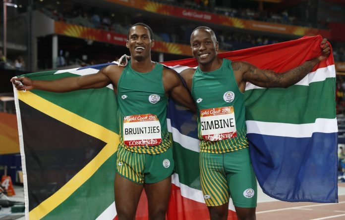 Gold medalist Akani Simbine silver medalist Henricho Bruintjies.