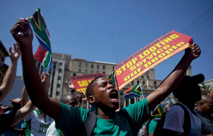 Protesters in Pretoria's Church Square on Friday expressed their anger at a 'looting' government.