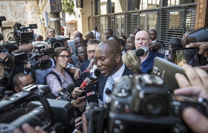 A sea of reporters greeted Democratic Alliance leader Mmusi Maimane outside the Constitutional Court