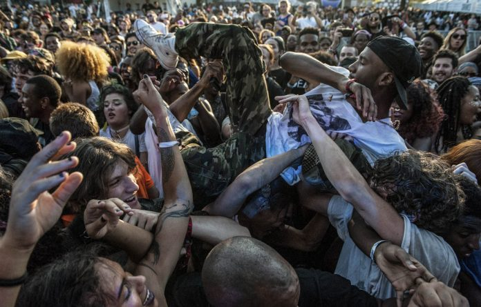 Crowdsurfing while the band Trash Talk performs at the Afropunk festival in New York last year.