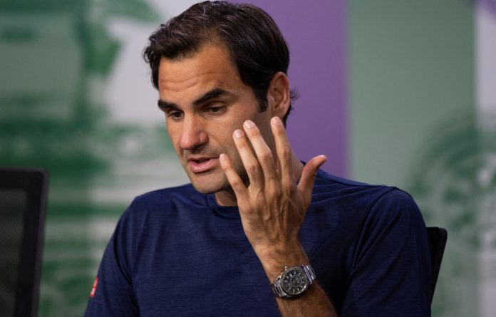 Switzerland's Roger Federer attends a press conference after losing his quarter final match against South Africa's Kevin Anderson.