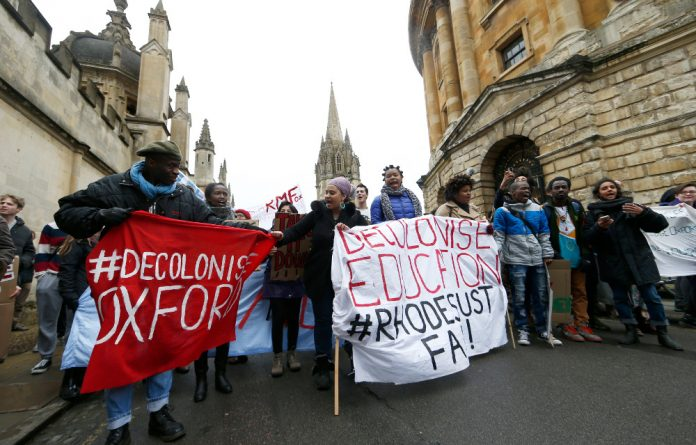 Students march past the Radcliffe Camera during protest