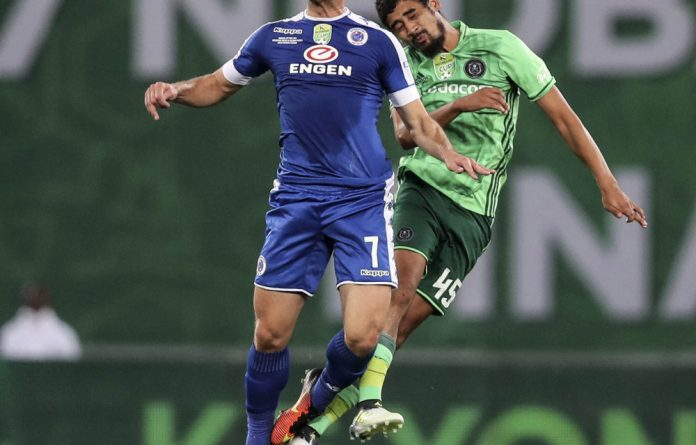 Chip off the old block: Bradley Grobler beats Abbubaker Mobara to the high ball in the Nedbank Cup final between Orlando Pirates and SuperSport United on June 24.