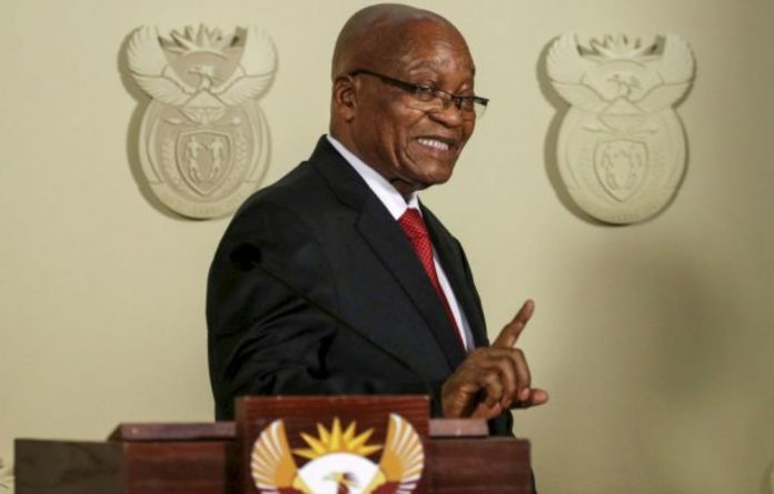 President Jacob Zuma gestures after announcing his resignation on Wednesday.