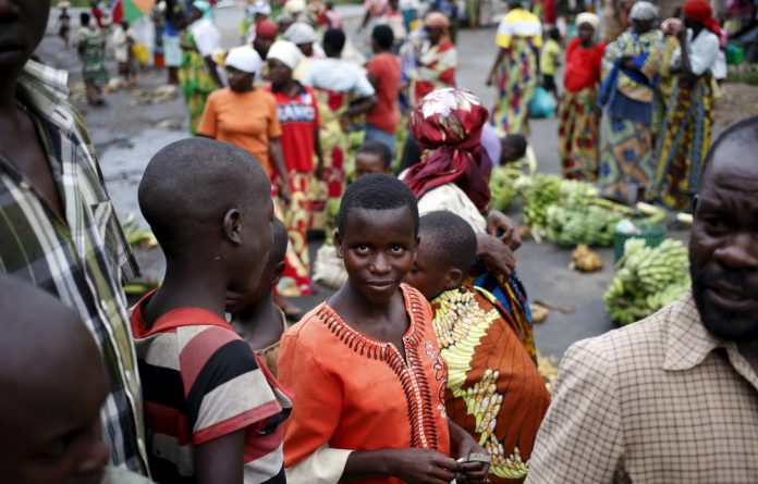 People selling fruit and other products in the market in a village near Bujumbura