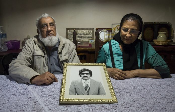 Ismail Haffejee and Sarah Lall with a portrait of their brother Hoosen Haffejee