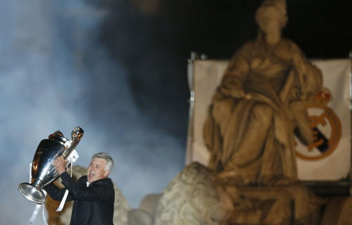 Real Madrid's coach Carlo Ancelotti celebrates after winning the Champions League final on Saturday night.