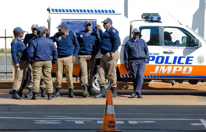 Police are probing the Johannesburg metro police for allegedly using an unauthorised blue light convoy to escort the Zimbabwean police commissioner.