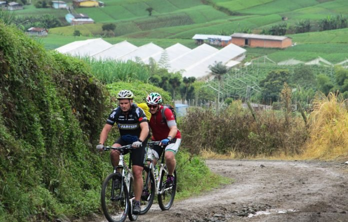 A wheel adventure: Greg Mills and Lyal White on their cycling tour of Columbia which included other unusual modes of transport.