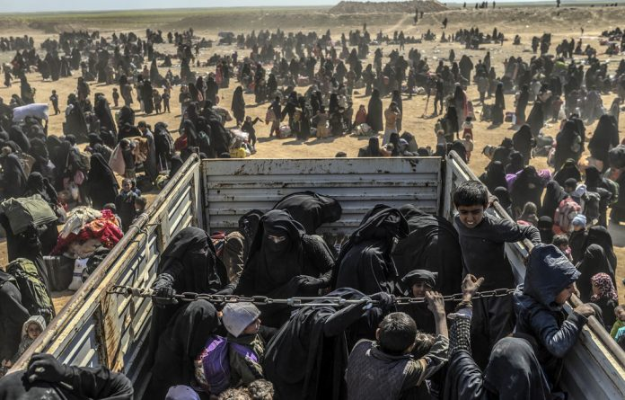 Lost: People evacuated from Syria's last Isis-held holdout of Baghouz are transported to the Al Hol refugee camp. South African Safiya Ganchi and her children may be among them.