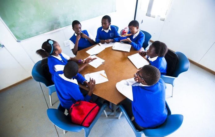 Pupils at Tsakane's African School for Excellence work together in small groups.