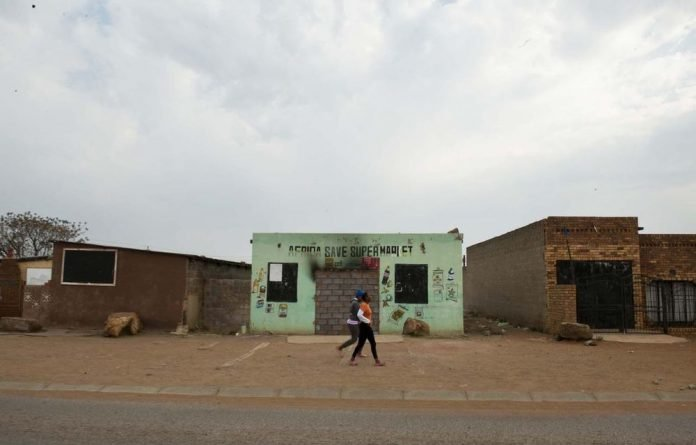 A bricked-up shop after the violence.