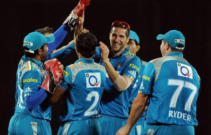 Pune Warriors cricketers greet teammate Wayne Parnell.