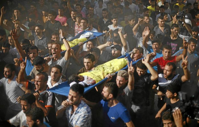 Mourners carry the bodies of two boys from the Bakr family in Gaza City.