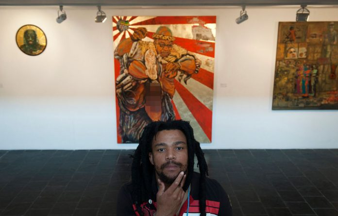 Artist Ayanda Mabulu poses with his controversial painting