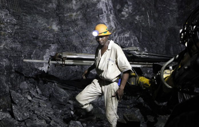 A mine worker is seen underground at a mine outside Johannesburg.