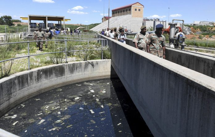 Emergency: Members of the SANDF at the Vaal River water purification plant in Sebokeng in January.