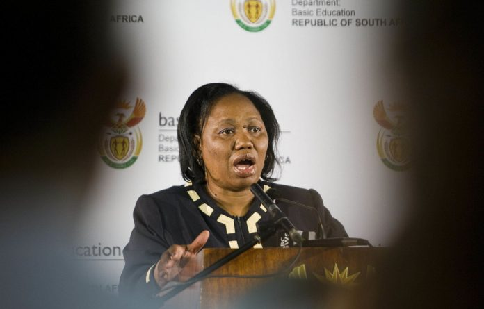 Basic Education Minister is pushing to ensure that thousands of teachers who resigned don't get reappointed as teachers.