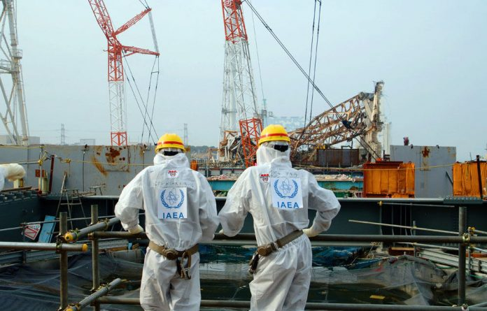 Shinzo Abe's pledge came as the world's nuclear watchdog urged Japan to explain more clearly what is happening at Fukushima.