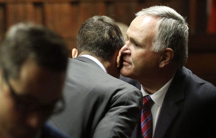 Barry Roux speaks to Oscar Pistorius at the Pretoria Magistrate's Court in June 2013.