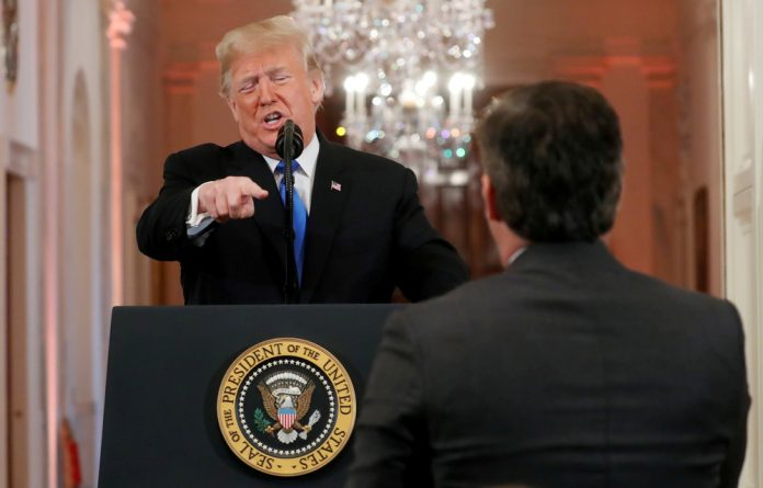US President Donald Trump points at CNN's Jim Acosta and accuses him of