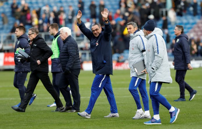 Chelsea manager Maurizio Sarri waves to the fans at the end of the match