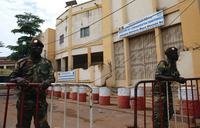 Soldiers stand guard outside Mali's Ministry of Territorial Administration in Bamako.