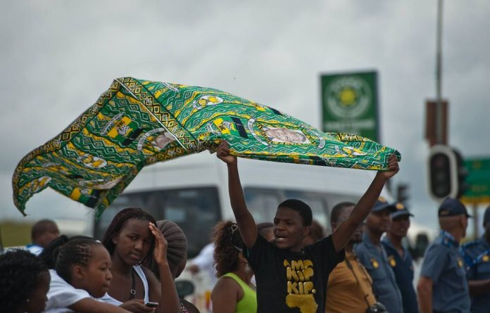 Members of the public line the route to Mandela's funeral in the Eastern Cape.