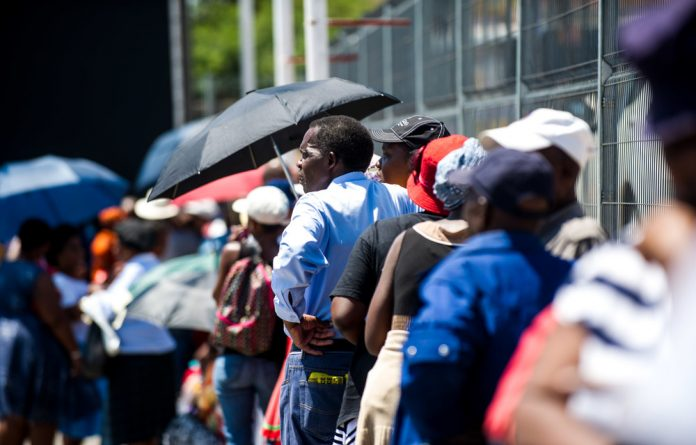 Social standing: Grant beneficiaries queuing to collect their money in Alexandra