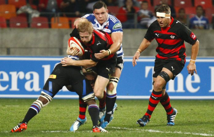 Scott van Breda of the EP Kings is tackled from behind during the Absa Currie Cup match between Eastern Province Kings and DHL Western Province at Nelson Mandela Bay Stadium in Port Elizabeth.