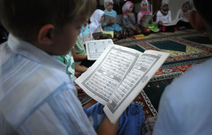 Amnesty International has urged Pakistan to protect a Christian girl arrested for allegedly burning pages inscribed with verses from the Qur'an.