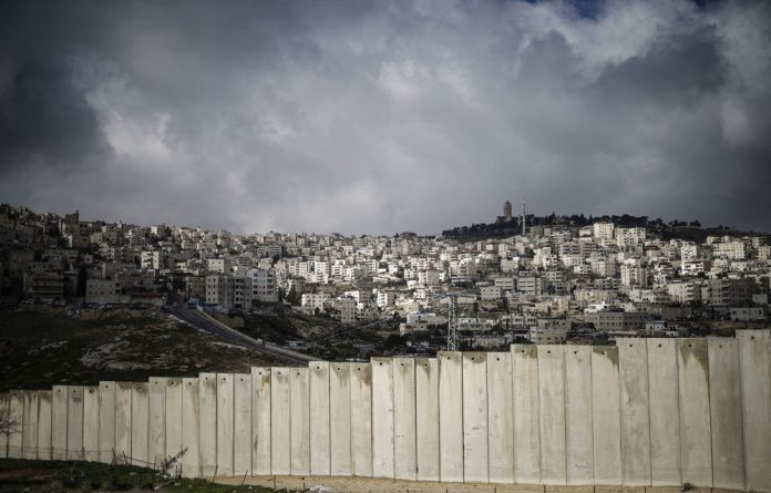 Peace in resistance: The Israeli barrier which separates the Palestinian West Bank village of Eizariya