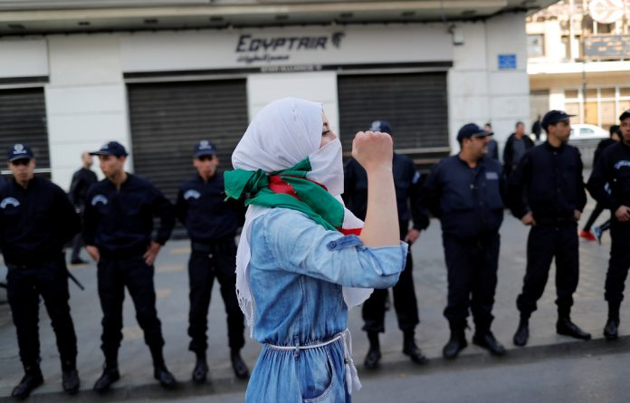 A student protests against Algeria's President Abdelaziz Bouteflika