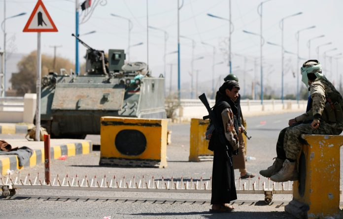 Houthi fighters secured an entrance to the presidential palace in Sanaa on Thursday.