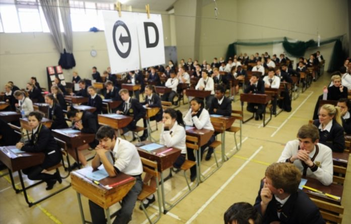 Matric pupils waiting anxiously to start their examinations.