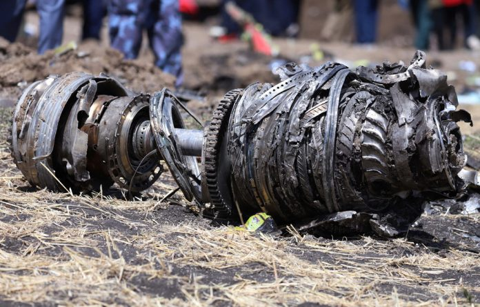 Airplane engine parts are seen at the scene of the Ethiopian Airlines Flight ET 302 plane crash