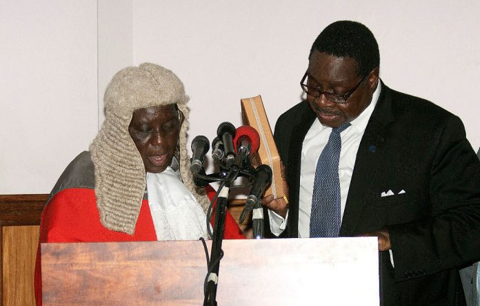 Malawi President Peter Mutharika takes the oath of office on May 31 2014.