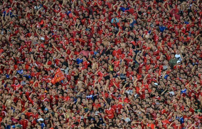 Fans of Egypt's Al-Ahly cheer for their team