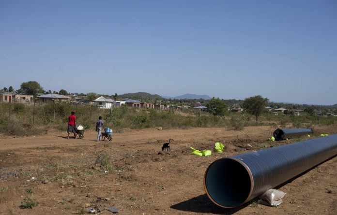 Double trouble: Water pipes lie around the troubled Vuwani area in Limpopo waiting to be installed. The Vhembe municipality is in financial difficulty yet has been charged with servicing Vuwani. Photo: Oupa Nkosi