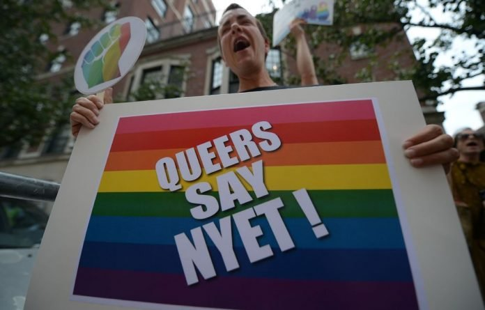 Protesters hold a demonstration against Russia's President Vladimir Putin's stands on gay rights