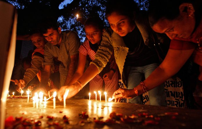 People light candles during a prayer ceremony to mark the first anniversary of the Delhi gang rape.
