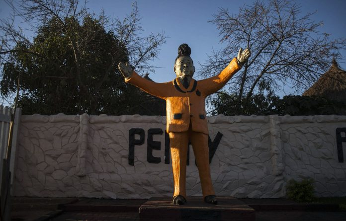 The entrance to Papa Penny's house boasts a giant statue of the maverick musician