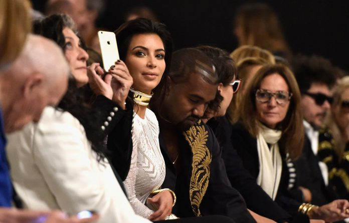 Kim Kardashian and Kanye West at the Balmain show during Paris Fashion Week Womenswear Spring/Summer 2015.