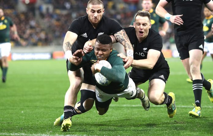 Aphid Dyantyi of South Africa scores a try during The Rugby Championship match between the New Zealand All Blacks and the South Africa Springboks at Westpac Stadium on September 15