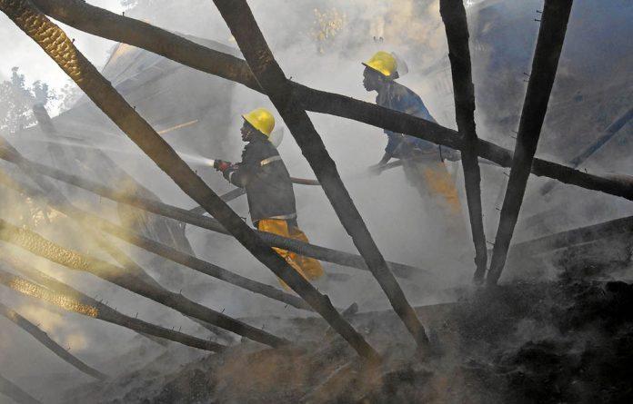 Firemen extinguish a fire in a church in Eldoret