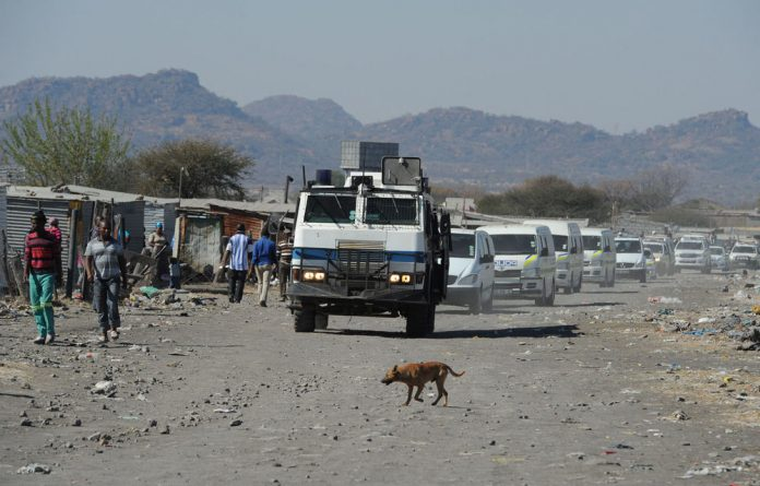 Police say the situation has calmed at Lonmin's Marikana mine in the North West.