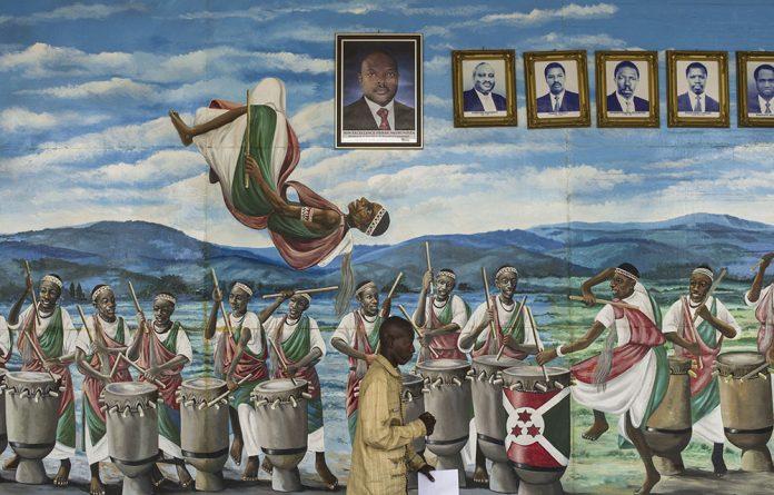 Burundi's presidents on a mural.